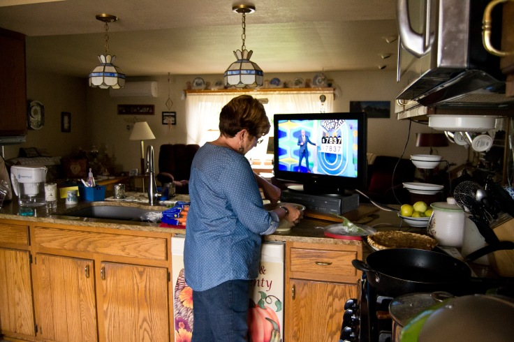 """Wendy Carey prepares food for lunch, that they call """"noon dinner"""" or her husbands and sons, on September 26, 2016."""